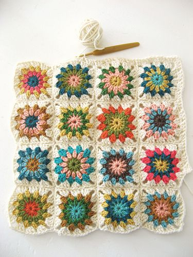Granny circles in a square. love the colors...bright but muted, a little darker than pastel, pink/blue/brown, green/orange/gold but not too 70s.