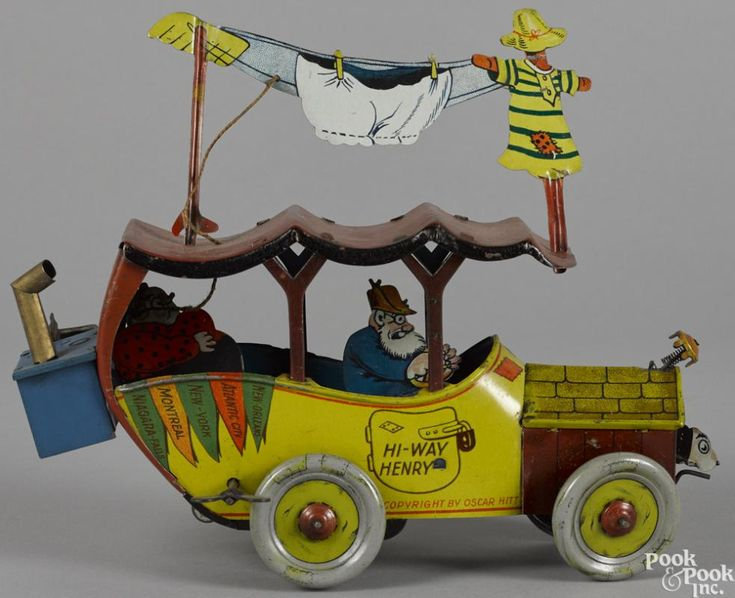 Fischer tin lithograph wind-up Hi-Way Henry touring car with the original stove, 8 1/2'' l. - Price Estimate: $300 - $400