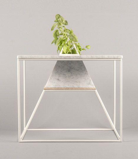 Plants grow inside Maxim Scherbakov's marble Sputnik-5 table.