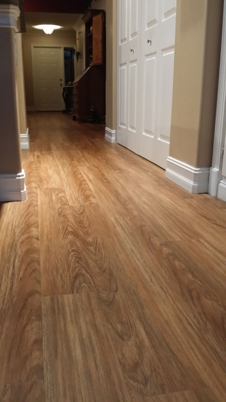 New Engineered Vinyl Plank flooring called Classico Teak from Shaw that we recently installed for Butch and Nancy D. in Lake Worth Fl.