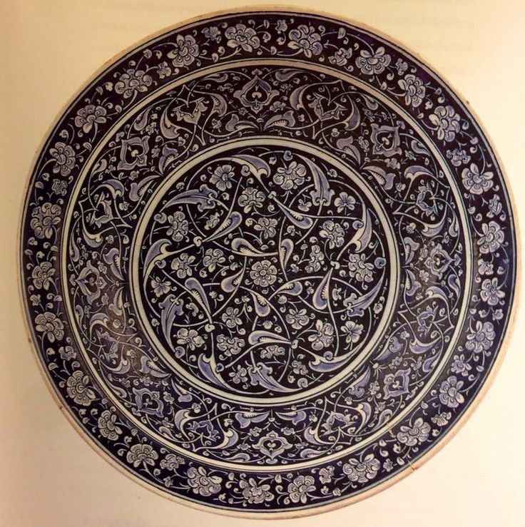 """Fig. 150 - Fritware dish underglaze painted in cobalt blue, c. 1480, Iznik. Gemeente-museum, The Hague. perhaps one of the finest examples (this style) of Islamic ceramic. Unusually high technical standard and quite large piece. 17 3/4"""" pg 280."""