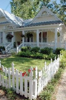 Developed after the turn of the century, the Oaks District is characterized by wide oak-lined streets and historic homes (such as the gingerbread styled one at left*).  Hattiesburg, MS