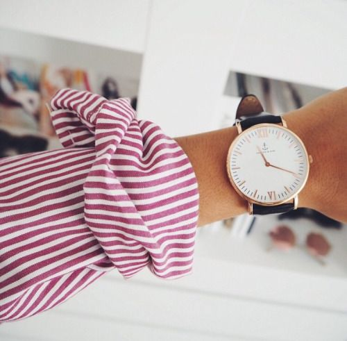 The modern woman sporting a classic man's watch--it's about time!