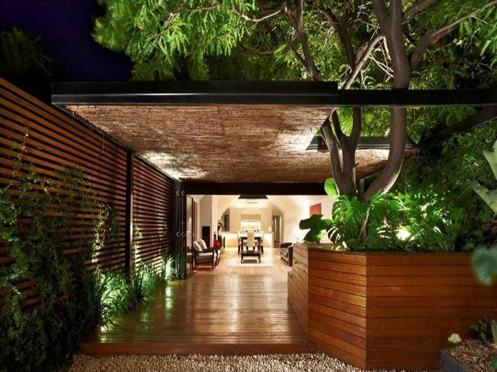 A narrow single fronted house in Port Melbourne, Australia (5) ... outdoor space.. love the cut-out in the roof for the tree..gorgeous!