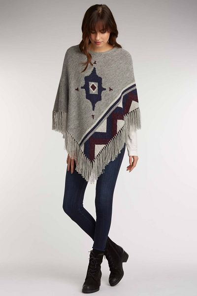 Beautiful, thick and warm poncho made of baby alpaca wool. The fiber is light but warm and soft. Fair Trade, made by the artisans in Peru.