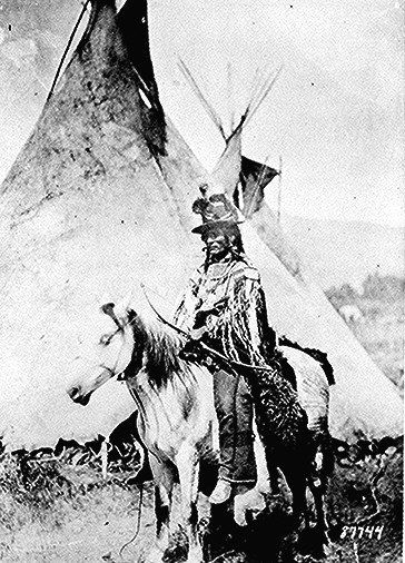 Looking Glass, a Nez Perce' chief, on horseback in            front of a tepee. Photograph, 1877.     American Indian Select List number 106.