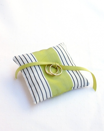 A colorful ring pillow made of striped ribbon