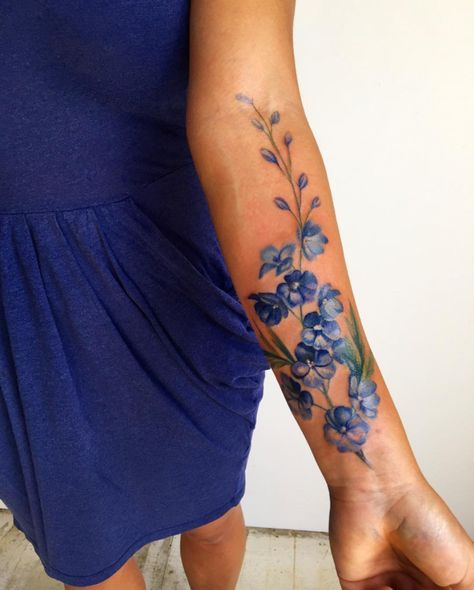 This floral watercolor tattoo is SO pretty.
