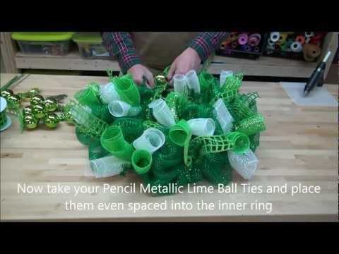Designer David Elder shows you how to make a St. Patricks Day Deco Mesh Wreath using supplies available at Creativegiftpackaging.com  Wreath Supplies:                                                   Product Number 24 Emerald Metallic Pencil Twist Work Wreath          #XX741806 21 Emerald w/Emerald Foil Poly Deco Mesh             #RE100106 1...