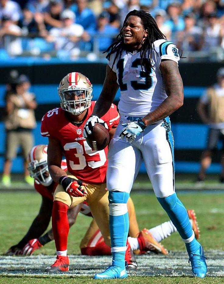 Carolina Panthers wide receiver Kelvin Benjamin's, right, celebrates his catch…