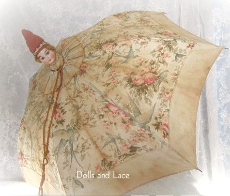 UMBRELLA~Child's antique parasol with bisque doll head.