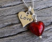 Murano glass tiny love heart pendant with Sterling Silver 'love' charm. We have shown this here in Red but we can make this in any of our colours
