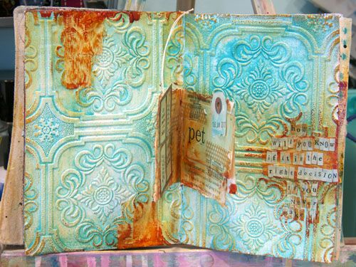 Donna uses textured wallpaper to make these pages