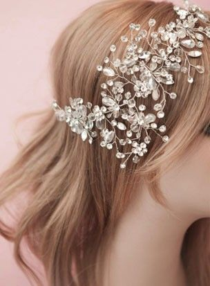 """""""Jewelled Accents"""" Crystal Bridal Headpiece A luxurious and extravagant headpiece. Delicate hand wired crystals and rhinestones adorn this sparkling piece, which lays flat and wraps around the crown, filling out just above the eye. $99.95 including gift box and FREE shipping in Australia."""