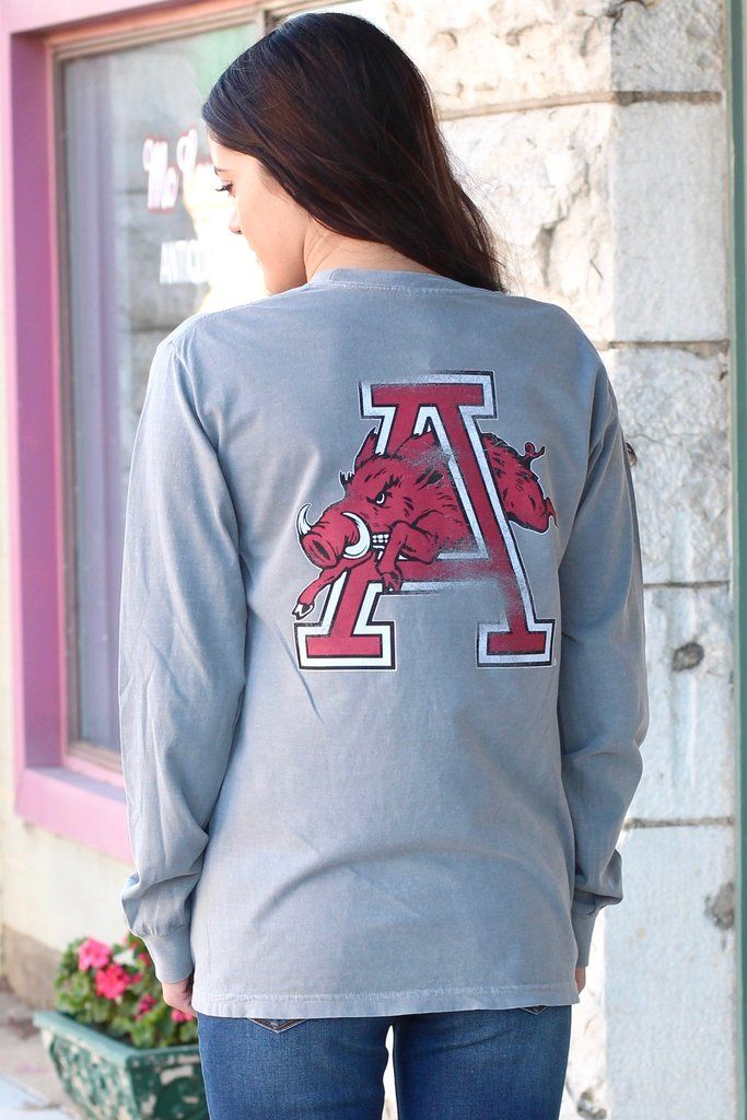 "Long sleeve t-shirt with vintage Arkansas Razorback logo of the hog through the ""A"" on the back and front left chest. Grey in color. Comfort Color brand shirt."