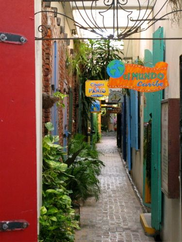 Shopping in Charlotte Amalie, St. Thomas, Virgin Islands - this is one of the many tiny alleys between what were the warehouses on the dock in times past.  The warehouses are not filled with little shops selling everything from lace and rum to seashells and leather goods. - it is fun just to wander through and if you are not careful - get quite a buzz from rum samples