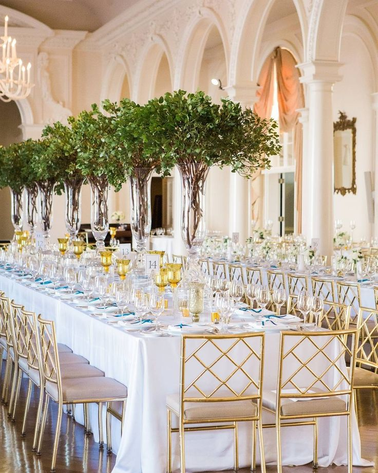 Tree Centerpieces, Long Table & Gold Modern Chairs | Photo: Vue Photography.