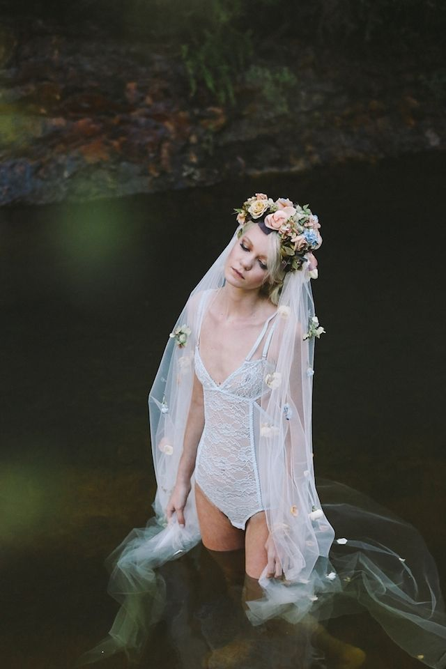 Boudoir shoot in the water with a flower covered veil | Lara Hotz Photography for Hooray Magazine with styling by Stefanie Ingram, beauty by Liv Lundelius Makeup Artist and floral design by Jardine Botanic Floral Styling | see more on: http://burnettsboards.com/2014/07/ophelia-enchanting-fashion-boudoir-editorial/