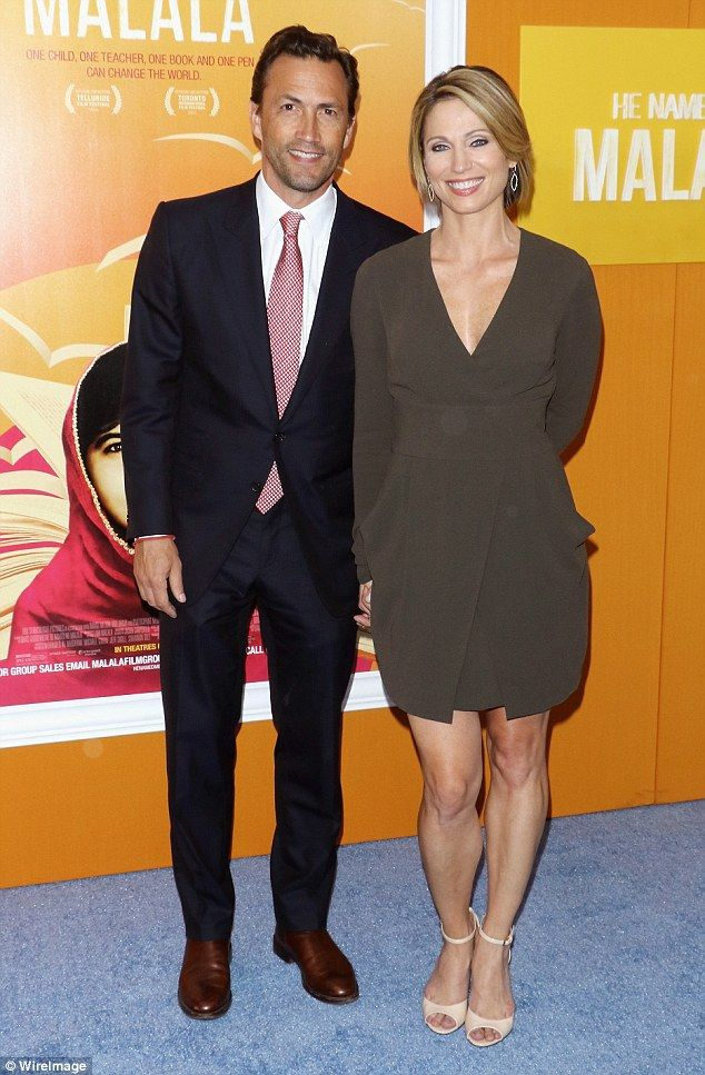 'Massive ups and downs': Amy Robach, 42, has revealed that her battle with breast cancer nearly destroyed her marriage to former Melrose Place star Andrew Shue, 48; the couple was pictured September 24