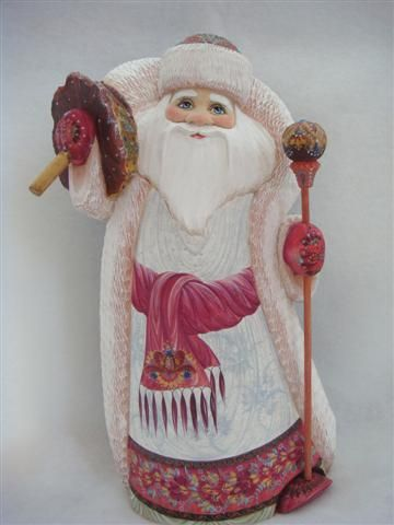 muted colors and beautifully designed back of cloak on this hand crafted wooden Russian Santa