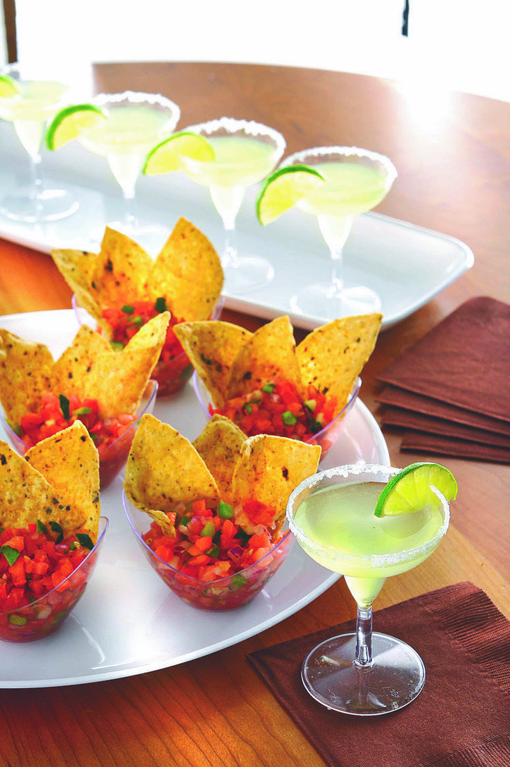 Party Appetizers: Salsa in a small cup with a couple of chips.