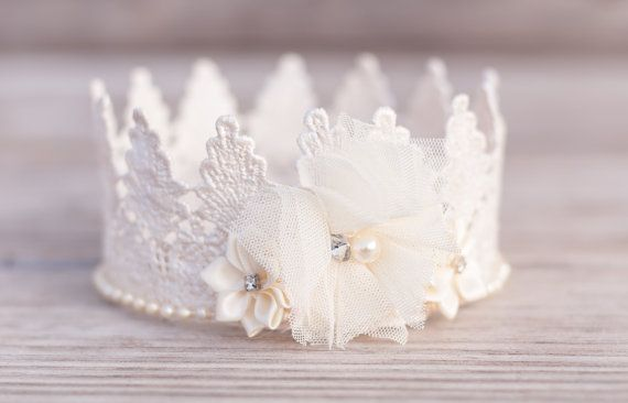 Lace crown in ivory, perfect for princesses of all ages! Lots of natural textures, beautiful colors, and totally fun! Perfect for your little ones photo shoot, birthday party or for a pageant costume. Comes attached to a super stretchy ivory elastic headband. Also available in