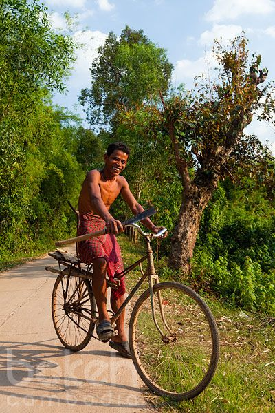 Khmer farmer with machete on bicycle | Kampong Cham Province, Cambodia