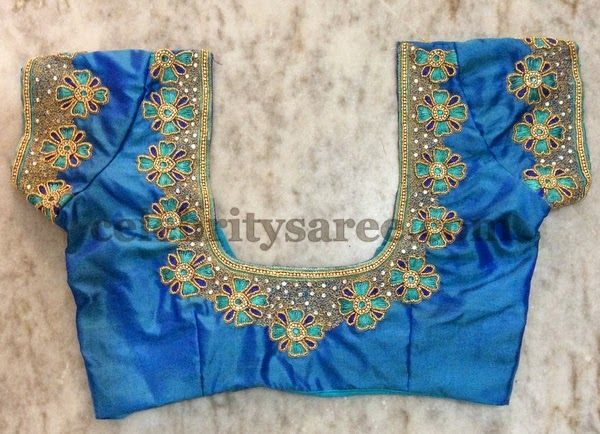 Sky blue raw silk designer blouse looks gorgeous with simple design. Nice floral work design embellished across the neck. Studded with co...