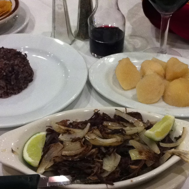 Vaca frita, black beans and rice, and sweet potato with a glass of Tempranillo at La Rosa restaurant in Miami