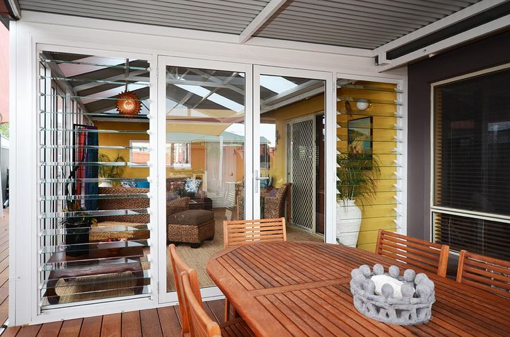 Aluminium French doors with Breezway louvre sidelites in Perth