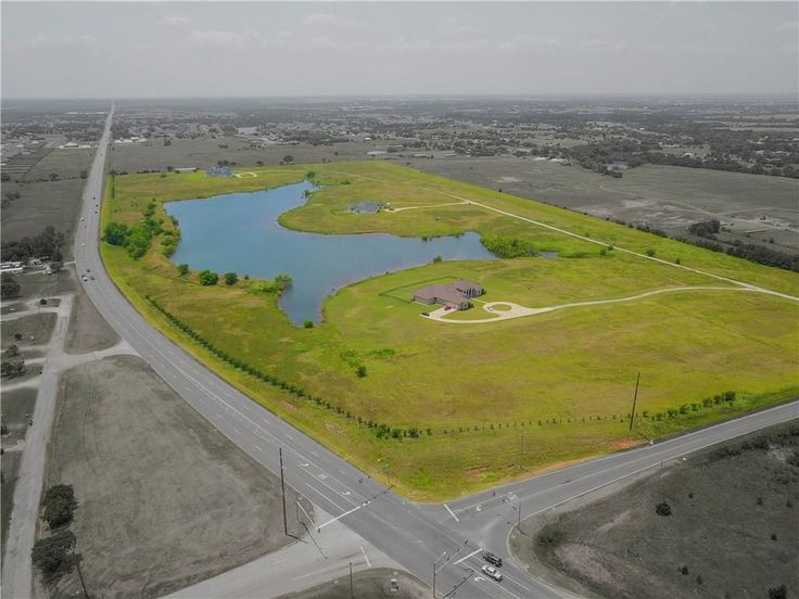 48 acres of grassy hills, scattered trees, plus a gorgeous 16+ acre lake stocked with bass and catfish - SE 134th St, Oklahoma City, OK 73165 (MLS #779285) - Contact The RED Team - Kim Spencer, Terra Myers and Kiley Hendley - Keller Williams Realty Central Oklahoma 405-410-9696 for more information or your personal tour!