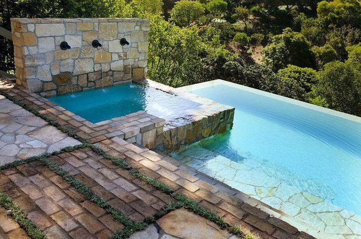 backyard infinity pool with square hot tub
