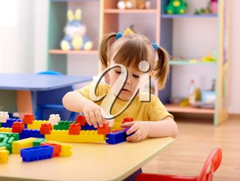 Royalty Free Photo of a Little Girl Playing With Blocks