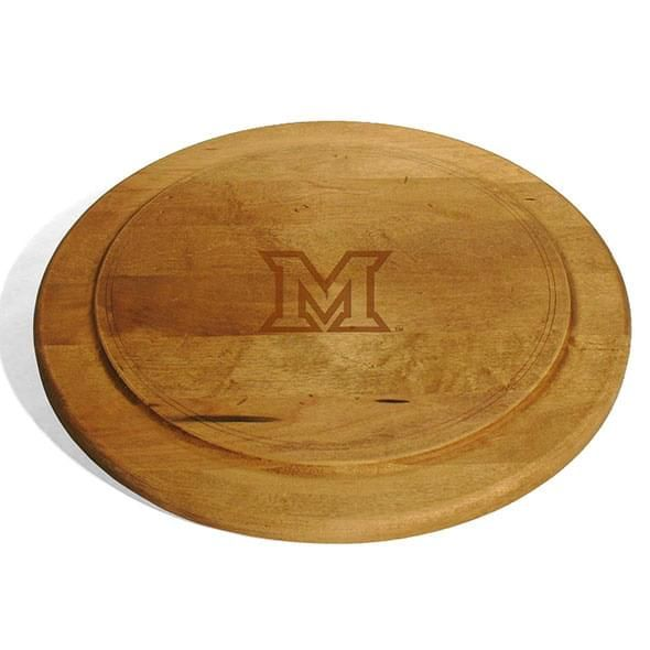 The Miami University in Ohio Round Bread Server is perfect for bread, cheese or whatever you choose. Sanded by hand to a smooth, beautifully worn finish, featuring the Miami logo. Measures 13 x 13 x 3/4 in. Made in Vermont from solid Maple.