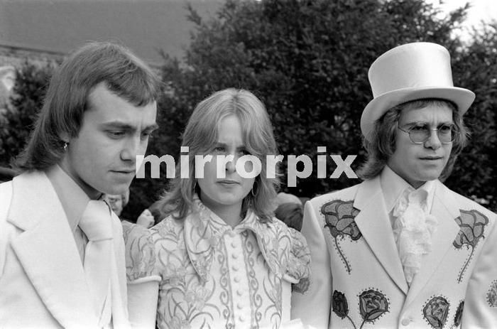 Elton John as best man to his songwriting partner Bernie Taupin. Bernie marries 19 year old American student Maxine Feibelman on Saturday 27th March 1971 at Holy Rood Catholic Church, in Market Rasen, Lincolnshire.