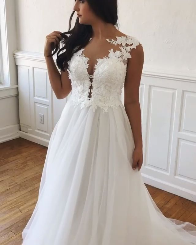 This beautiful boho gown has 3D lace with an illusion neckline and back and a soft tulle skirt. You can find this dress @ Breeze Boutique in Columbia, MO.