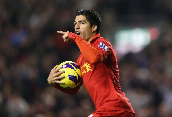 Luis Suarez of Liverpool celebrates scoring his team's first goal to make the score 1-1 during the Barclays Premier League match between Liverpool and Newcastle United at Anfield on November 4, 2012 in Liverpool, England