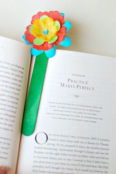 DIY Pretty Flower Bookmarks:  Popsicle sticks, any sort of paint or dye, some decorative flowers, and a little bit of glue will make this fun, summery bookmark!