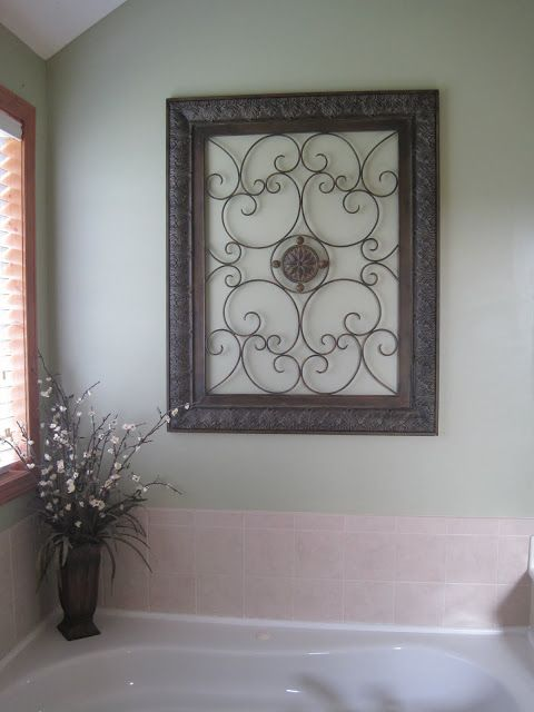 Wrought iron art work above the jacuzzi tub. Perfect for couples bathroom...  Tuscan Bathroom DecorBathroom Wall ...