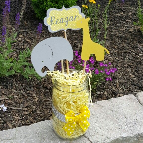 Gray and yellow giraffe and elephant baby shower centerpiece