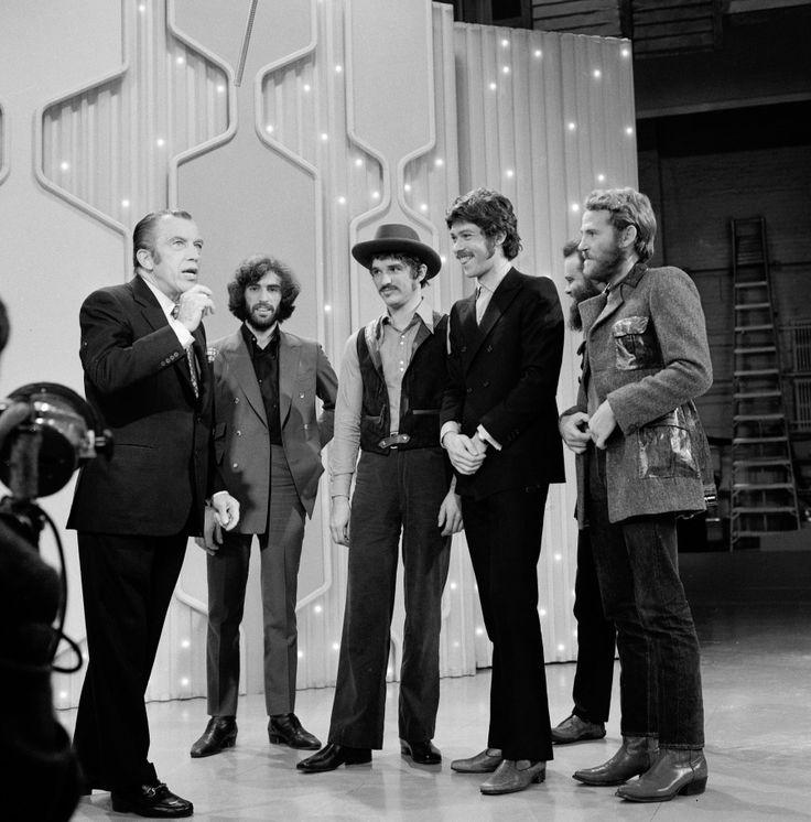 The Band, (from left) Richard Manuel, Rick Danko, Robbie Robertson, Garth Hudson & Levon Helm, greet variety show host Ed Sullivan in New York on November 2, 1969.