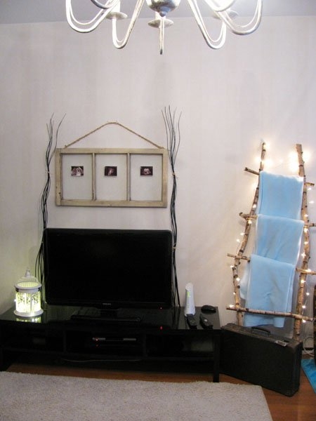 Home made ladders, old suitcase, old window and birdcage with lights.Old Suitcases