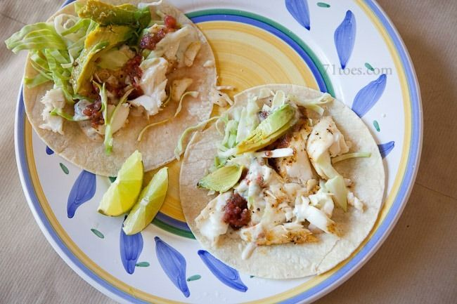 Fish tacos. Marinade: 2 cloves garlic, 1/2 cup parsley, 1 lemon, 1/2 cup olive oil, 1/4 cup red wine vinegar, 1 tbsp oregano, 1/2 tsp pepper, 2 dashes hot sauce. Marinate 4 pieces of tilapia for 20-30 min. Grill on high 3-5 min each side until flakes. Sauce: 1/4 cup mayo or plain greek yogurt, 1 tbsp lime juice, 2 tbsp cilantro, 1 clove garlic, 1/8 tsp cumin, 1 tbsp water. Serve with lime wedges and avocado.