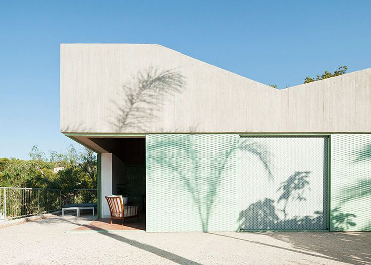 Concrete house by Langarita-Navarro photographed as a crime scene