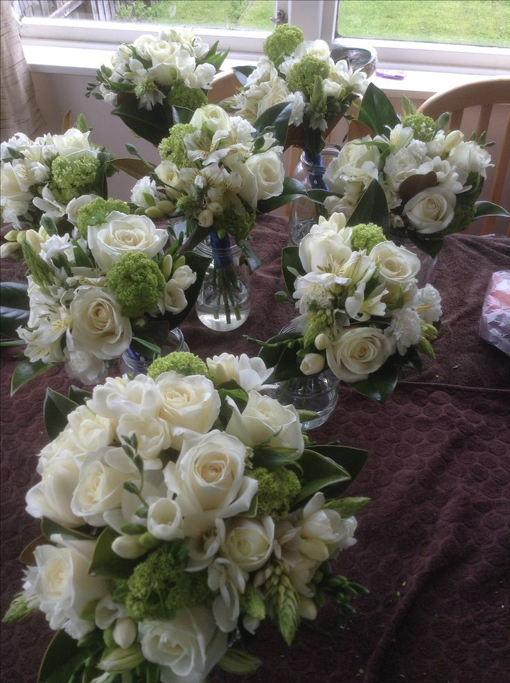 Brides bouquet and 7 bridesmaids bouquets done on a tight budget.