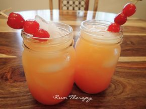 Coconut Rum Punch! Refreshing, tropical and you can make it in a large batch for end of summer get-togethers!