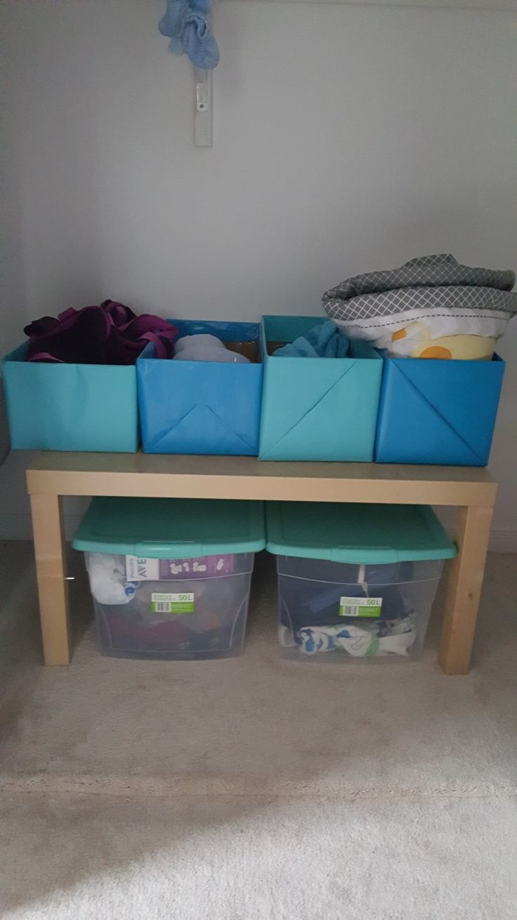 Closet Organization---DIY baby room closet organization--use old diaper boxes and wrap them with the color of your choice. Wrapping paper from Dollarama dollar store. Choose from all the colors!