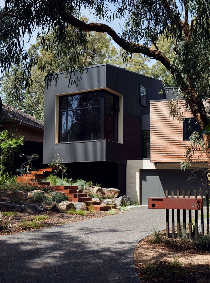Iron, concrete block and wood cladding