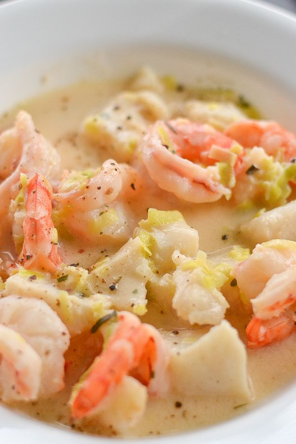 Shrimp and Fish ChowderIngredients  •2 tablespoons unsalted butter  •1 leek (white and light green parts only), thinly sliced  •2 tablespoons all-purpose flour  •1 ½ cups chicken broth  •½ cup 10% half and half cream  •1 lb large shrimps or tiger prawns  •14 oz cod fillets or other white fish fillets, cut in 1-inch pieces  •½ teaspoon dried tarragon  •½ teaspoon grated lemon zest  •2 tablespoons lemon juice  •¼ teaspoon pepper