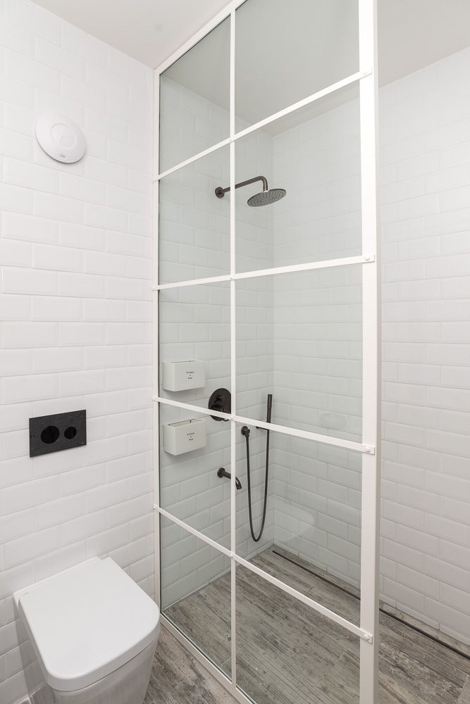 white steel factory window as a shower partition